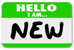 A green nametag sticker with the words Hello I Am New for a rookie, trainee, new staff hire, newbie,